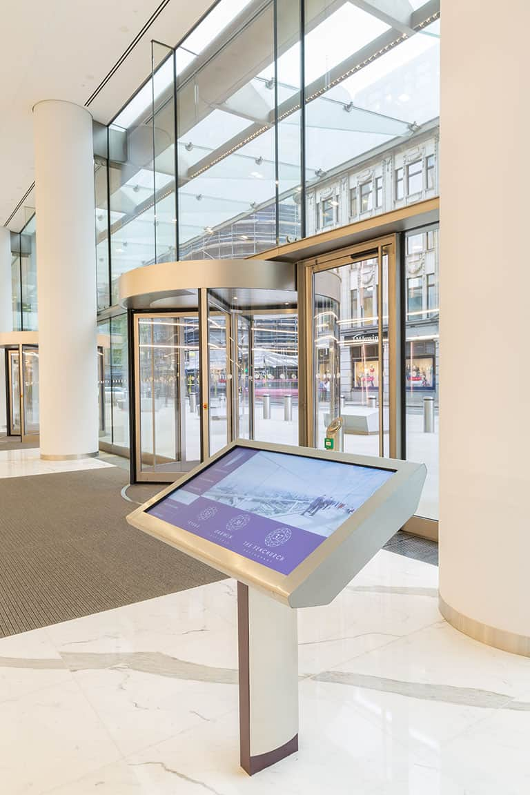 Example of digital wayfinding signage - interactive tenant directory within an office building