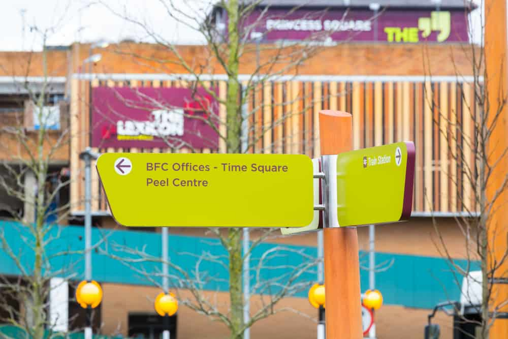 Close up of the directional prompt signs designed as part of The Lexicon, Bracknell wayfinding scheme. Showing the layout of the content and the construction of the fingerpost signs