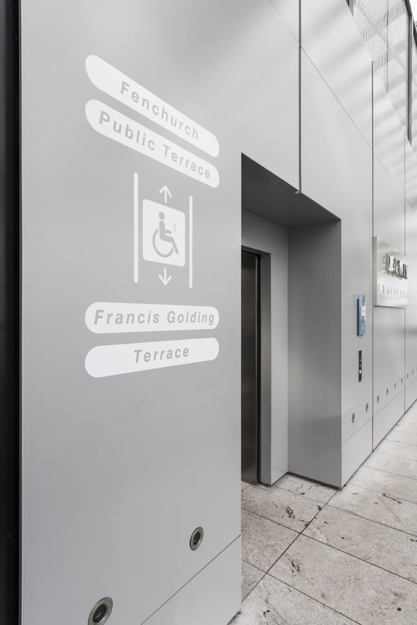 Lift index sign for disabled access applied to the external wall of the elevator lobby