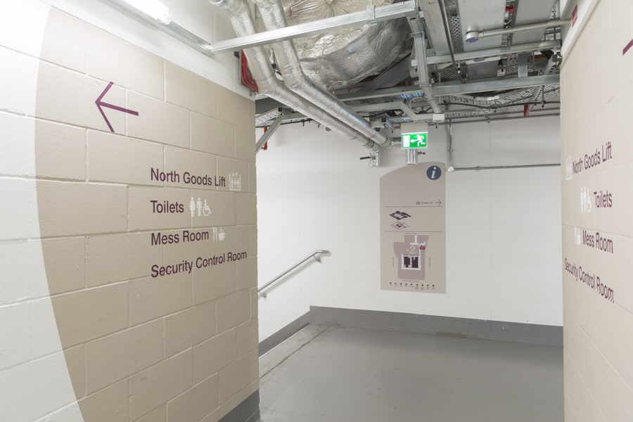 Basement plan sign accompanied by large scale graphics providing directional information