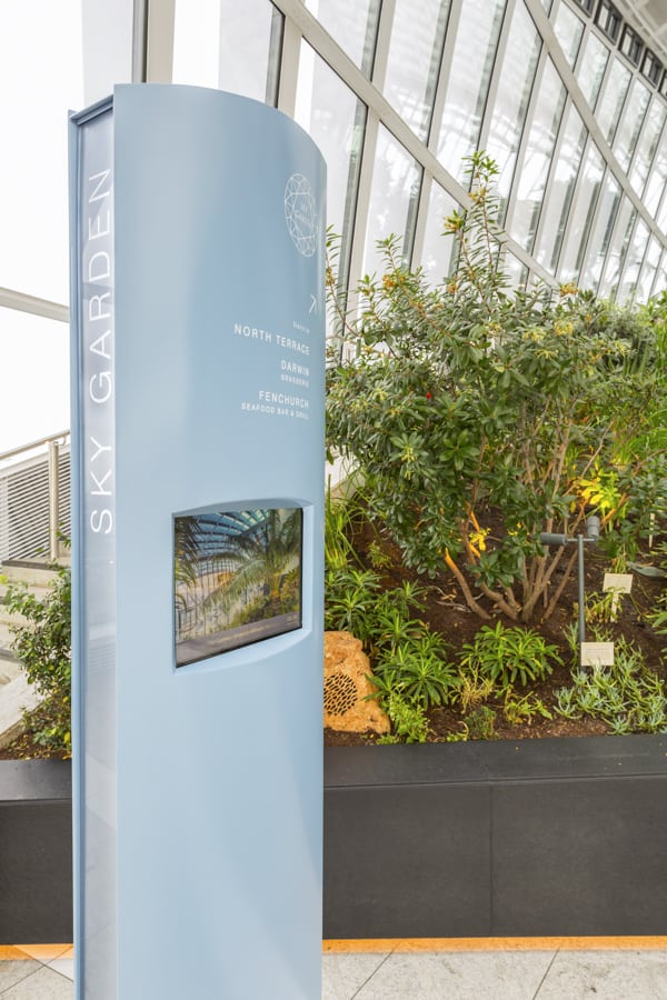 Totem sign located within the Sky Garden with an integrated digital screen