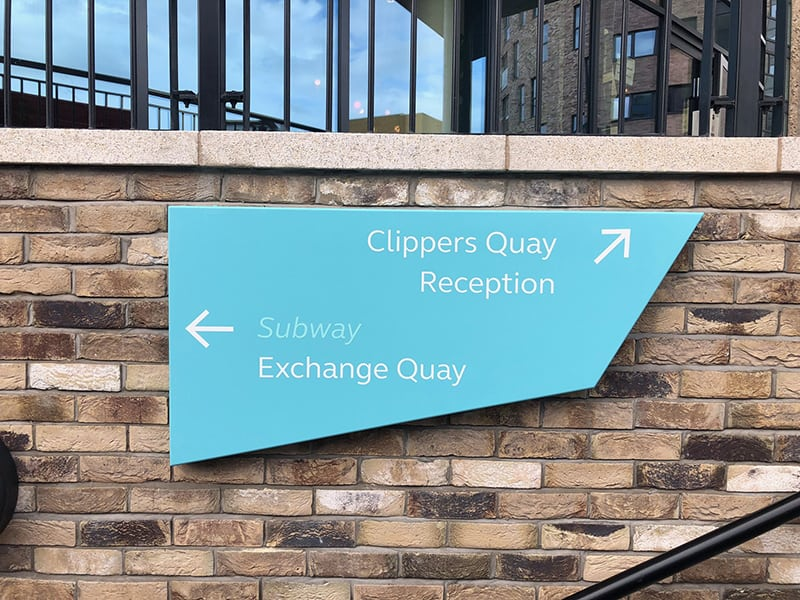 Direction sign applied to a wall in the Clippers Quay development