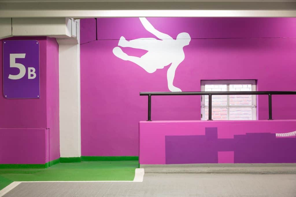 Large Parkour supergraphic that plays off the handrail barrier on level 5b of the Boar Lane car park in Leeds
