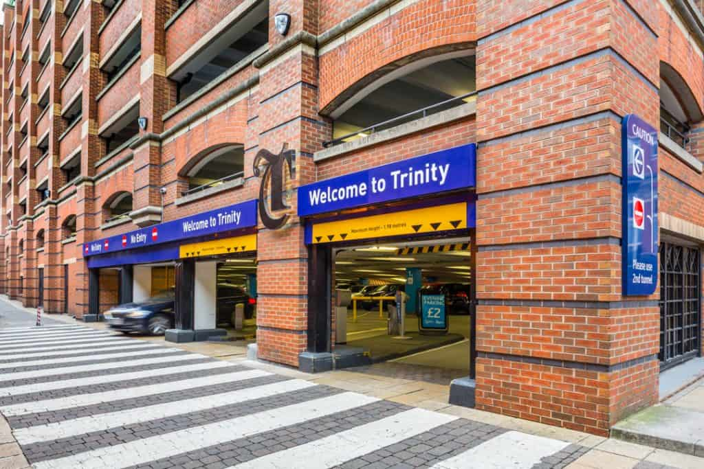 Welcome signs and external branding at the entrance to the Trinity Leeds car park