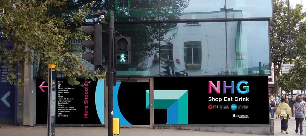 Black vinyl hoarding, with a large pink, purple, blue and green lettering applied to the glass in an empty shop front in Notting Hill Gate