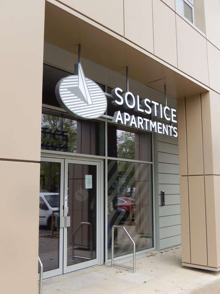 Entrance sign over the door at Solstice Apartments