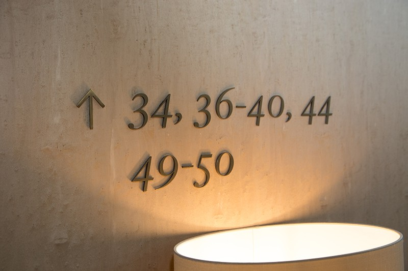 Example of apartment directional information applied as individual numbers and symbols to the wall