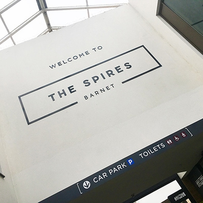 Welcome sign at the entrance to the Spires Shopping Centre in Barnet
