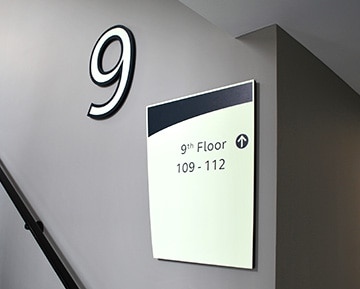 Wayfinding signs in the stairwells in Gatehouse Apartments Southampton